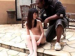 Tiny Japanese girl gags on big ebony salami outdoors