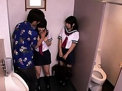 Japanese schoolgirls threeway pummel with man in restroom