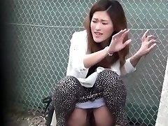 Oriental mega-slut pee public