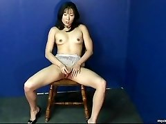 Super-sexy Asian babe rubbing on her wet cooter