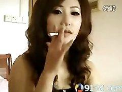 ultra-cute chinese female smoking
