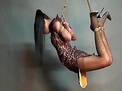 Yaner extreme hogtie-drape contest