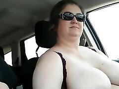 Wife driving with her enormous tits out