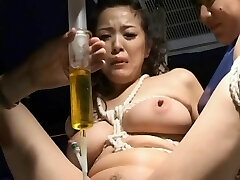 BDSM: Asian w catheter drained and re-filled