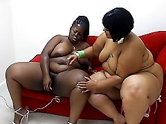 Black BBW lesbians play with a strap-on