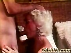 Retro Grey Haired Granny Gives Sensual Inhale and Hooter Job