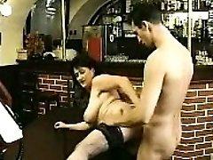 Brunette in stockings sucks big cock and penetrates it