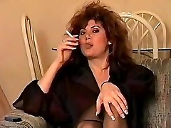 Old-school early 90's smoking with big hair, flawless.