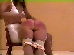 spanked in old-school lingerie