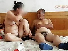 Chinese grandfather giving it to grandma from behind