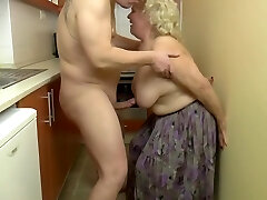 Insatiable, blonde granny is playing with her tits and her lovers jizz-shotgun, in the kitchen