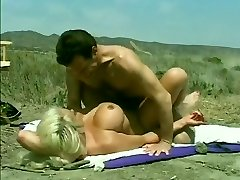 Classic Hugetitted Babe Pulverized on Beach
