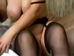 I am this super-naughty slut with gigantic amateur tits, who is wearing high heels, while fucking a massive black dildo.