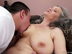 Sex-starved grandmother with big natural tits gives hot blowjob to her lover