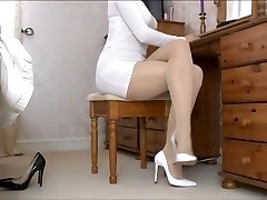 Lady Tan Pantyhose legs and white shoes .