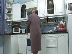 grandmother masturbates in the kitchen