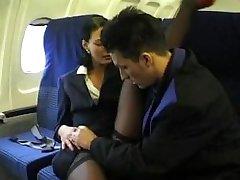 Brunette beauty wearing stewardess uniform gets fucked on a plane