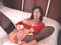 British MILF fucks herself with a pair of high heeled shoes