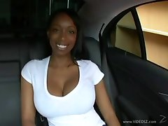 Wonderful big titted black girl fucks in a car a big white cock