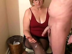 Mrs. Watson gives her neighbour a hand job