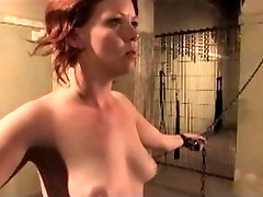 Redhead is chained, cropped, and clamp