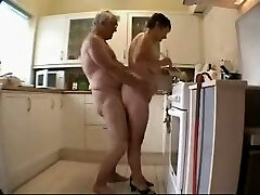 Old duo having fun in the kitchen