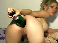 Naughty blonde uses the big end of a bottle to stick in her donk