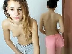Two schoolgirls after school disrobe in front of the webcam for money.