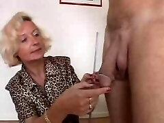 Italian Granny enjoys Two cocks