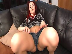 Nikita's tights make her wank her cunt on sofa