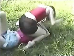 Catfight on grass