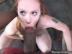 As this scene opens, redhead Scarlett is laying on her bed,