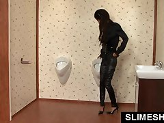 Skinny girl on her knees at gloryhole toilet