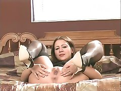Milf brunette in sexy lingerie strips and shows her pussy