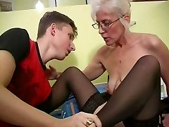 Mature with Silver Hair Glasses and Stockings Wakes the Fellow