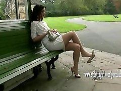 Pretty babe shows off her silky sleek nylon gams and posh high heels