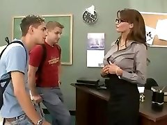 Big-chested brunette schoolteacher fucks and sucks her two students in threesome