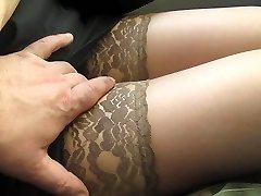 Touching her legs in tan tights in a bus