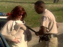 Redhead MILF Marilyn Chambers humping police