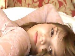 Petite 18yo girl teasing herself on sofa