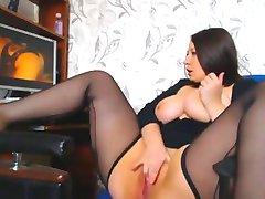 A woman with beautiful curves masturbates watching a porno