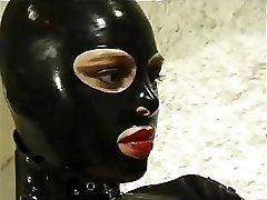 Steamy cat woman in leather suit does anything she wants to her kinky slave