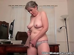 Old secretary Kelli strips off and thumbs her hairy pussy