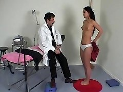 French doctor performs a utter physical examination