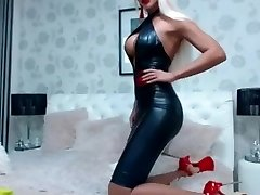 Hot girl in Latex dress and magnificent high heels