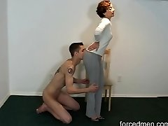 Naked marionette licks mistress' legs for worship