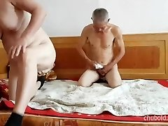 Handsome Chinese grandpa giving plowing