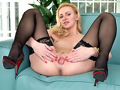 Hot milf masturbating in black stockings