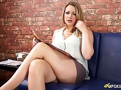 Appealing Penny Lee flashing bald pussy upskirt in softcore video