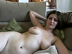 Busty mature brunette with huge boobs and hairy pussy takes off